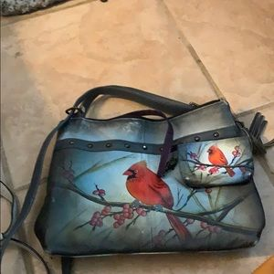Hand bag by Anuschka with coin purse